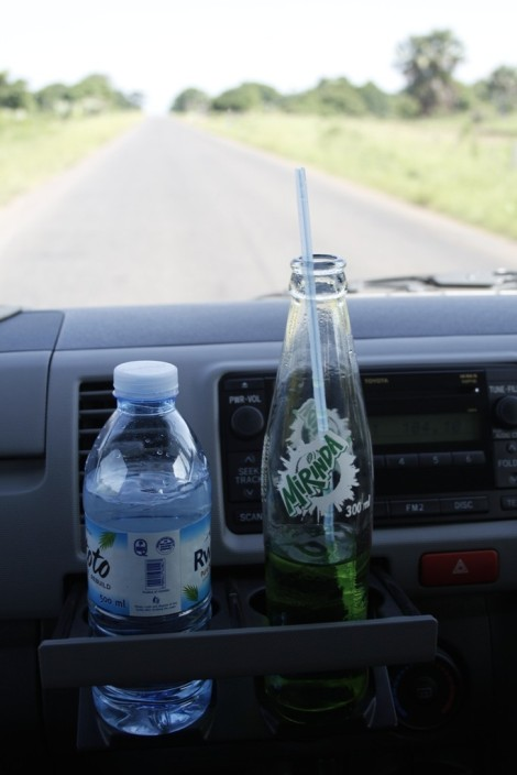 Staying hydrated is important on long road trips. But remember, there is really only one bathroom break on the road to Gulu.