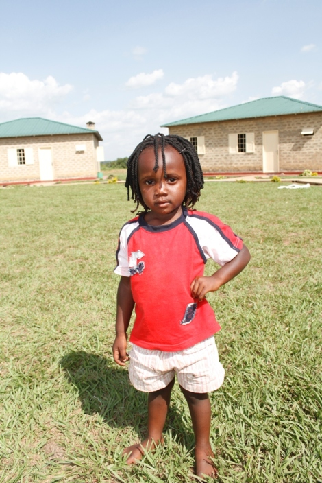 A young girl stops to pose for a quick picture. Watoto Child Care Ministries currently helps support more than 2,600 orphans at three different villages across Uganda.