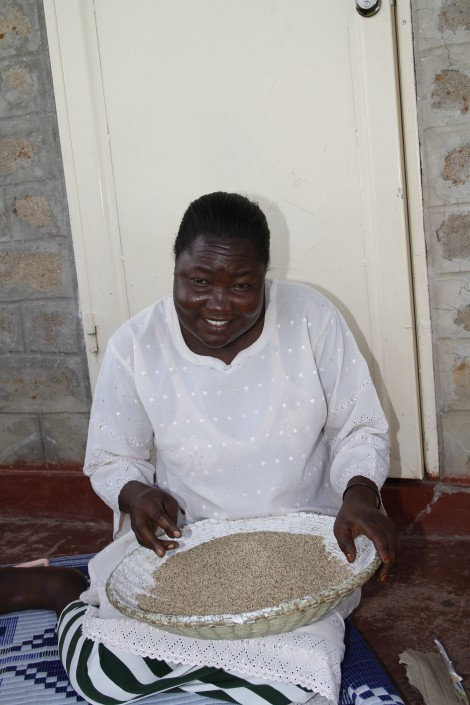 One of the house mothers prepares dinner for her children at the Watoto children's village in Luminadera.